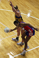 Mystics goal attack Pamela Cookey tries to stay in the field of play under pressure from Pulse captain Cushla Lichtwark during the ANZ Netball Championship match between the Central Pulse and Northern Mystics, TSB Bank Arena, Wellington, New Zealand on Monday, 4 May 2009. Photo: Dave Lintott / lintottphoto.co.nz