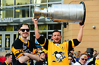 May 29, 2017: Pittsburgh Penguins fans hold up a model Stanley Cup outside the PPG Paints arena before game one of the National Hockey League Stanley Cup Finals between the Nashville Predators  and the Pittsburgh Penguins, in Pittsburgh, PA. Pittsburgh defeats Nashville 5-3 in regulation time.  Eric Canha/CSM