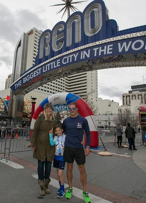 Jr 1 Mile winner Rhys Ferrito, center, with mom Megan Schuster and dad Roberto Ferrito during the 6th Annual Reno 5000 Downtown River Run on Saturday, April 6, 2019.