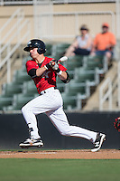 Danny Mendick (1) of the Kannapolis Intimidators follows through on his swing against the Greenville Drive at Intimidators Stadium on June 7, 2016 in Kannapolis, North Carolina.  The Drive defeated the Intimidators 4-1 in game one of a double header.  (Brian Westerholt/Four Seam Images)