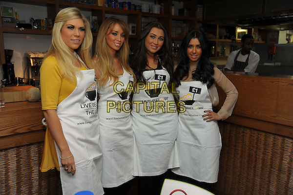 Frankie Essex, Lauren Pope, Lauren Goodger & Peri Sinclair.The Live Below The Line celebrity charity cook-off, Shoreditch Waterhouse restaurant, Orsman Rd., London, England..March 5th, 2012.half 3/4 length white apron yellow beige top.CAP/CAS.©Bob Cass/Capital Pictures.