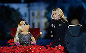 Actress Reese Witherspoon and Miss Piggy speak from the stage during the National Christmas tree lighting ceremony on the Ellipse south of the White House December 3, 2015 in Washington, DC. The lighting of the tree is an annual tradition attended by the President and the first family.<br /> Credit: Olivier Douliery / Pool via CNP