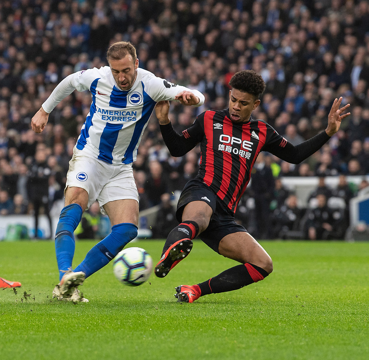 Brighton & Hove Albion's Glenn Murray (left) is tackled by  Huddersfield Town's Juninho Bacuna (right) <br /> <br /> Photographer David Horton/CameraSport<br /> <br /> The Premier League - Brighton and Hove Albion v Huddersfield Town - Saturday 2nd March 2019 - The Amex Stadium - Brighton<br /> <br /> World Copyright © 2019 CameraSport. All rights reserved. 43 Linden Ave. Countesthorpe. Leicester. England. LE8 5PG - Tel: +44 (0) 116 277 4147 - admin@camerasport.com - www.camerasport.com