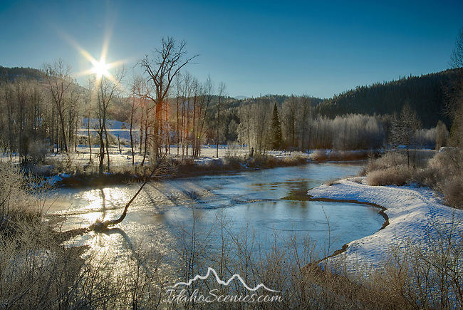 Idaho, North, Shoshone County, Idaho Panhandle National Forest. The Coeur d'Alene River in the morning sun on a cold frosty winter day.