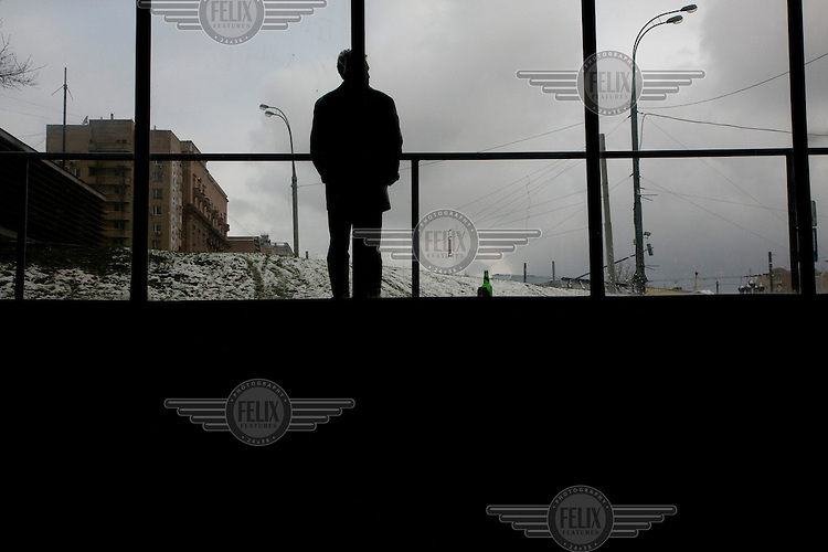 A man drinks beer at a metro stop in Moscow. .Picture by Justin Jin.