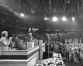 Alf Landon, the 1936 Republican nominee for President of the United States, waves to the delegates from the podium of the 1976 Republican National Convention at the Kemper Arena in Kansas City, Missouri on August 17, 1976.  Landon's daughter, Nancy Landon Kassebaum applauds at far left.<br /> Credit: Arnie Sachs / CNP