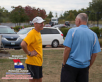 Lafayette Girls Coach Scott Brandon visits with and thanks Dale Shepherd for putting on the 2013 Parkway West Cross Country Invitational.