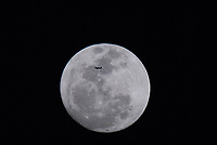 Kissimmee, Florida. USA, March 18,  2011    <br /> A passenger jet flies in front of the Supermoon  as it rises over Kissimmee Florida. Credit: Mark Reinstein/MediaPunch