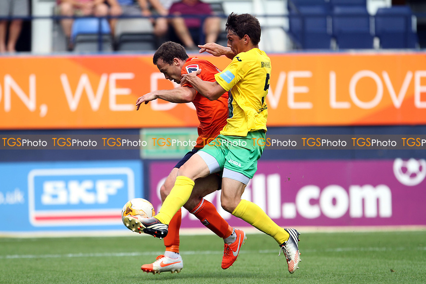 Jannes Vansteenkiste (Royal Antwerp) wins the ball - Luton Town vs Royal Antwerp - Pre-Season Friendly Football Match at Kenilworth Road, Luton, Bedfordshire - 26/07/14 - MANDATORY CREDIT: Mick Kearns/TGSPHOTO - Self billing applies where appropriate - contact@tgsphoto.co.uk - NO UNPAID USE