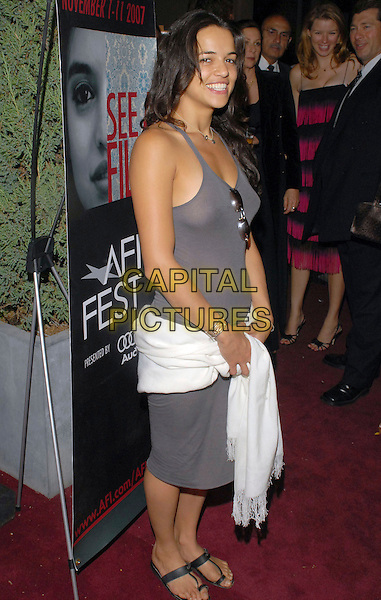 MICHELLE RODRIGUEZ.AFI Festival party during the Toronto International Film Festival 2007 held at the W Studio,  Toronto, Ontario, Canada, 08 September 2007..full length grey vest dress sunglasses shoes black sandals white pashmina scarf shawl.CAP/ADM/BP.©Brent Perniac/AdMedia/Capital Pictures.