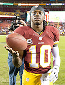 Washington Redskins quarterback Robert Griffin III twirls a football on his hand as he leaves the field following his team's 17 - 16 victory over the New York Giants at FedEx Field in Landover, Maryland on Monday, December 3, 2012.  .Credit: Ron Sachs / CNP