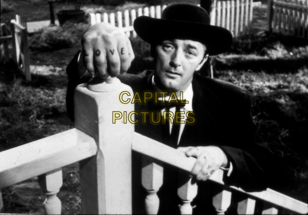 ROBERT MITCHUM.in The Night of the Hunter (1955).*Filmstill - Editorial Use Only*.CAP/FB.Supplied by Capital Pictures.