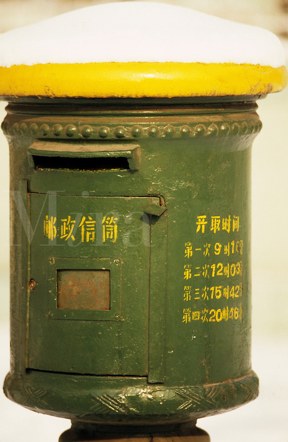 China. Tianjin.   Old fashioned post/mail box in the snow.