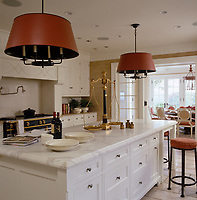 Marble topped work surfaces are a luxurious aspect of the large, bright and airy kitchen