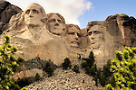 Mt Rushmore framed by pine trees in the national park in South Dakota