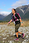 NELSON LAKES, NEW ZEALAND - APRIL 18:  Nicola Benzie crosses the Travers River during the 2015 Alpine Lodge Loop The Lake trail run at Lake Rotoiti on April 18 16, 2015 in Nelson, New Zealand. (Photo by Marc Palmano/Shuttersport Limited)