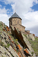 The church of the Trinity of Gergeti, built in the 14th-century and still in use today, perches at 2,170 metres on the side of the Kazbek mountain