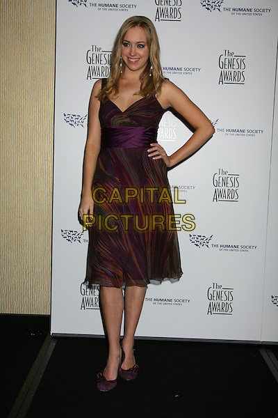 ANDREA BOWEN .22nd Annual Genesis Awards held at the Beverly Hilton Hotel,  Beverly Hills, California, USA,  29 March 2008..full length purple print patterned dress hand on hip .CAP/ADM/RE.©Russ Elliot/Admedia/Capital PIctures