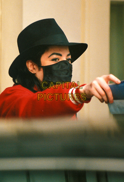 MICHAEL JACKSON.Leaving Holmes Place Gym,.London, 18th February 1996.portrait headshot black hat face cover mouth guard cloth red jacket.www.capitalpictures.com.sales@capitalpictures.com.©Capital Pictures