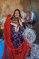 Fatima, 71, makes fishing nets to catch big fish on Kerkennah Island in Tunisia Her husband taught her how to make the nets as it used to be a man's job. She can make one in about six hours and makes 10 Dinars, about $4, per net.