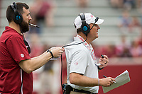 Hawgs Illustrated/BEN GOFF <br /> Chad Morris, Arkansas head coach, gets help with his headet Saturday, April 6, 2019, during the Arkansas Red-White game at Reynolds Razorback Stadium.