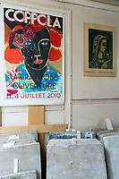 A 19th-century Paris printworks is defying its age and serving as a creative hub for contemporary artists. Posters and stones in the entrance hall.
