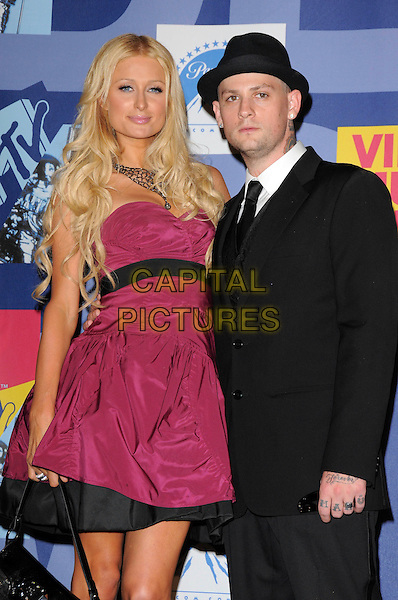 PARIS HILTON & BENJI MADDEN.Pressroom at The 2008 MTV Video Music Awards held at Paramount Studios in Hollywood, California, USA.  September 7th, 2008.VMA Vma half length pink purple dress suit jacket hat tattoo couple necklace strapless.CAP/DVS.©Debbie VanStory/Capital Pictures.