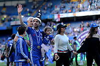Cesc Fabregas of Chelsea wearing his 'magic hat' waves at the fans as he walks around the edge of the pitch with members of his family during Chelsea vs Sunderland AFC, Premier League Football at Stamford Bridge on 21st May 2017