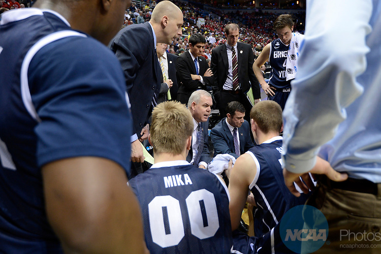 20 MAR 2014:  Head Coach Dave Rose Brigham Young University speaks during a timeout during the second round of the 2014 NCAA Men's Basketball Tournament held at the BMO Harris Bradley Center in Milwaukee, WI.  Oregon defeated BYU 87-68.  Jamie Schwaberow/NCAA Photos