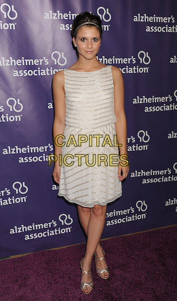 """Alexandra Chando.arriving at the 20th Anniversary Alzheimer's Association """"A Night At Sardi's"""" at The Beverly Hilton Hotel in Beverly Hills, California, USA, .March 21st, 2012..full length  white silver striped dress .CAP/ROT/TM.©TM/Roth Stock/Capital Pictures"""