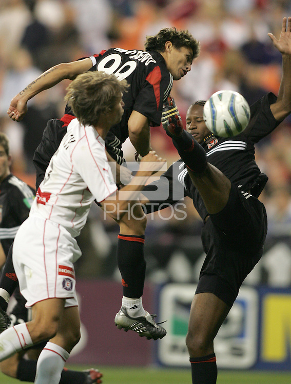 9 April 2005.  DC United's Jaime Moreno (99) tries to head the ball into the net while defended by Jesse Marsch (15) of Chicago at RFK Stadium in Washington, DC.