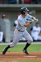 Rob Hudson #3 of the Birmingham Barons squares to bunt at Five County Stadium August 15, 2009 in Zebulon, North Carolina. (Photo by Brian Westerholt / Four Seam Images)