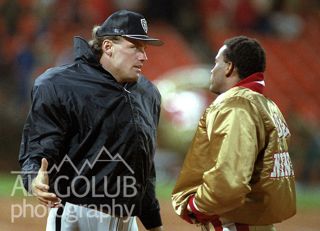 San Francisco 49ers vs. Los Angles Raiders at Candlestick Park Saturday, August 4, 1984..Pre-season Game. .Los Angles Raiders Defensive End Howie Long (75) and San Francisco 49ers Defensive Back Ronnie Lott (42) talk after game..
