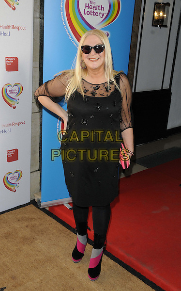 Vanessa Feltz.The Health Lottery Fundraising reception at Claridge's Hotel, London, England..28th March 2013.full length hand on hip black dress sheer pink clutch bag sunglasses shades .CAP/CAN.©Can Nguyen/Capital Pictures.