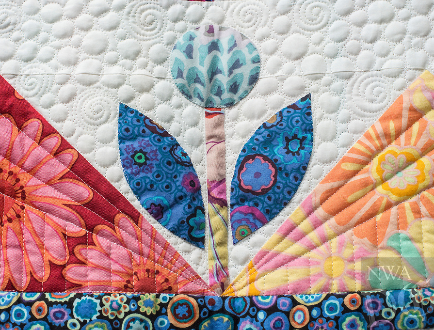 NWA Democrat-Gazette/ANTHONY REYES @NWATONYR<br /> Details on Carla Gray's &quot;Atomic Bloom&quot; quilt Monday, April 3, 2017 at the Shiloh Museum in Springdale.