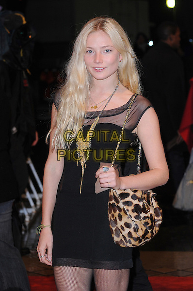 CLARA PAGET.Attending the UK Film Premiere of 'Red' at the Royal Festival Hall, London, England, UK..October 19th 2010.half length black sheer see thru mesh cut out leopard print bag gold chain strap dress .CAP/BEL.©Tom Belcher/Capital Pictures.