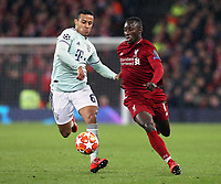 Bayern Munich's Thiago Alcantara vies for possession with Liverpool's Naby Keita <br /> <br /> Photographer Rich Linley/CameraSport<br /> <br /> UEFA Champions League Round of 16 First Leg - Liverpool and Bayern Munich - Tuesday 19th February 2019 - Anfield - Liverpool<br />  <br /> World Copyright © 2018 CameraSport. All rights reserved. 43 Linden Ave. Countesthorpe. Leicester. England. LE8 5PG - Tel: +44 (0) 116 277 4147 - admin@camerasport.com - www.camerasport.com