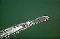 aerial view above tug boat pushing a barge in San Francisco bay