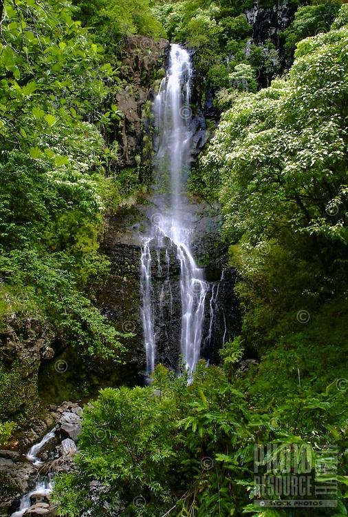 A tranquil waterfall seen along the Road to Hana, Maui.