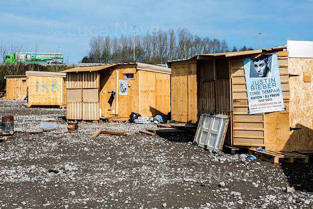 """Dunkirk Camp.<br /> <br /> Under the Sky of Calais & Dunkirk. Two Camps, Two Sides of the Same Coin: Not 'migrants', Not 'refugees', just Humans.<br /> <br /> France, 24-30/03/2016. Documenting (and following) Zekra and her experience in the two French camps at the gate of the United Kingdom: Calais' """"Jungle"""" and Dunkirk's """"Grande-Synthe"""". Zekra lives in London but she is originally from Basra in Iraq. Zekra and her family had to flee Kuwait - where they moved for working reason - due to the """"Gulf War"""", and to the Western Countries' will to """"export Democracy in Iraq"""". Zekra is a self-motivated volunteer and founder of """"Happy Ravers"""", a group of people (not a NGO or a charity) linked to each other because of their love for rave parties but also men and women who meet up every week to help homeless people and other people in need in Central London. (Here there are some of the stories I covered about Zekra and """"Happy Ravers"""": http://bit.ly/1XVj1Cg & http://bit.ly/24kcGQz & http://bit.ly/1TY0dPO). Zekra worked as an English teacher in the adult school at Dunkirk's """"Grande-Synthe"""" camp and as a cultural mediator and Arabic translator for two medic teams in Calais' """"Jungle"""". Please read her story at the beginning of this reportage."""