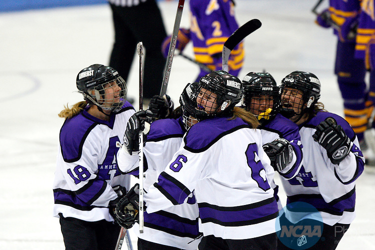 21 MAR 2009: Courtney Hanlon (6) of Amherst College celebrates with teammates after scoring a goal to make the score 1-1 during the 2009 NCAA Division III Women's Ice Hockey Championship held at Kenyon arena on the Middlebury College campus in Middlebury, VT.  Amherst defeated Elmira 4-3 in overtime to take home the National Championship.  Nancie Battaglia/NCAA Photos.