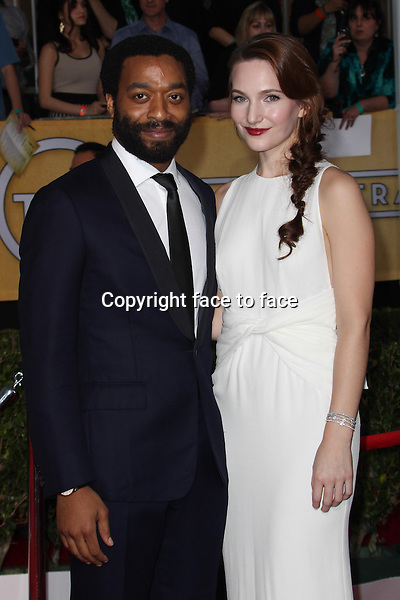 LOS ANGELES, CA - JANUARY 18: Chiwetel Ejiofor, Sari Mercer attending the 2014 SAG Awards in Los Angeles, California on January 18, 2014.<br /> Credit: RTNUPA/MediaPunch<br />