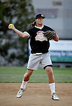 POWAY, CA - JULY 16:  Quarterback Philip Rivers of the San Diego Chargers throws a ball to first base for an out for his team the &quot;Valley Farm League&quot;  during their semi-final game in the Regular Joe League at the Poway Sportsplex Softball Field on July 16, 2014 in Poway, California. (CREDIT: Donald Miralle for the Wall Street Journal) <br /> chargers