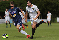 Auckland's Reid Drake chases Team Wellington's Eric Molloy during the 2018 OFC Champions League semifinal between Auckland City FC and Team Wellington at Kiwitea St in Auckland, New Zealand on Sunday, 29 April 2018. Photo: Dave Lintott / lintottphoto.co.nz
