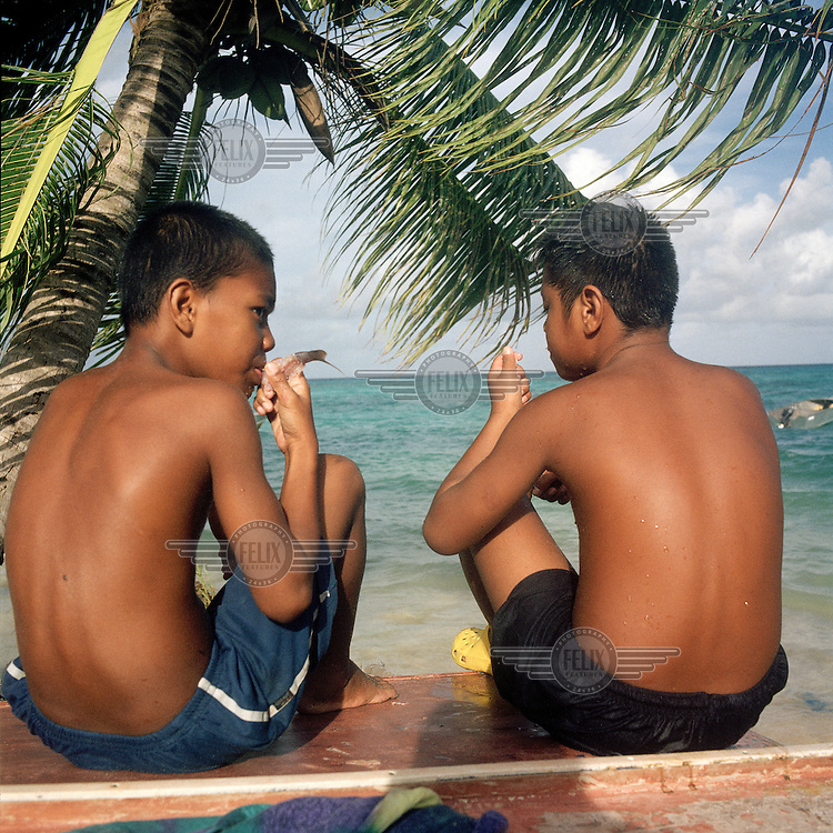 Boys and girls will play in the lagoon all day in the school holidays swimming, playing games, keeping cool in the hot tropical sun and when hungry catch and eat reef fish that goes especially well with fresh coconut from trees over head..