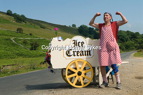 Man selling home made ice cream on the south side of River Warfe bank nr Hubberholm. Langstrothdale valley in the Yorkshire Dales National Park. Warfedale. North Yorkshire. He is trying top catch the attention of some cyclists who passing.  Roger Ingham MBE know as Mr Sport in Skipton