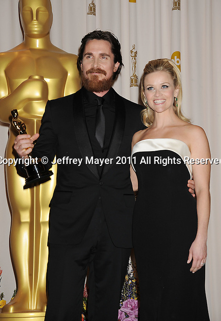 HOLLYWOOD, CA - FEBRUARY 27: Christian Bale and Reese Witherspoon  pose in the press room during the 83rd Annual Academy Awards held at the Kodak Theatre on February 27, 2011 in Hollywood, California.