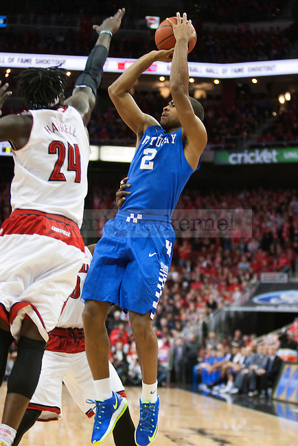Guard Aaron Harrison of the Kentucky Wildcats shoots during the game against  the Louisville Cardinals at KFC Yum! Center on Saturday, December 27, 2014 in Louisville `, Ky. Kentucky leads Louisville 22-18 at halftime. Photo by Michael Reaves | Staff