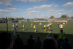 The visitors defending a corner in the second-half as East Stirlingshire take on Edinburgh City (in yellow) in the second leg of the Scottish League pyramid play-off at Ochilview Park, Stenhousemuir. The play-offs were introduced in 2015 with the winners of the Highland and Lowland Leagues playing-off for the chance to play the club which finished bottom of Scottish League 2. Edinburgh City won the match 1-0 giving them a 2-1 aggregate victory making them the first club in Scottish League history to be promoted into the league.
