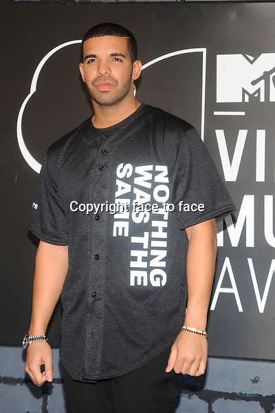 BROOKLYN, NY - AUGUST 25: Drake attending the 2013 MTV Video Music Awards at The Barclays Center in Brooklyn, NY on August 25, 2013. <br />